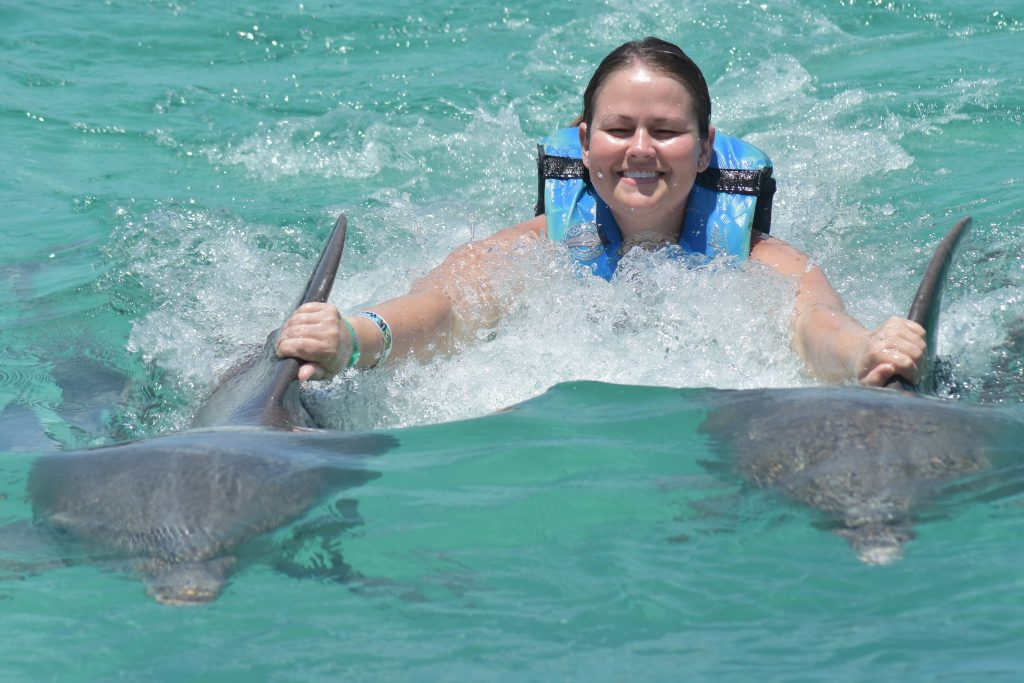Swimming with dolphins should definitely be on your list of 40 things to do before the age 40