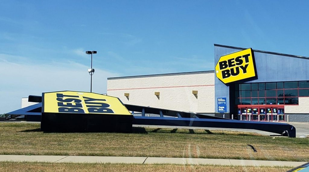Best Buy sign bent over.