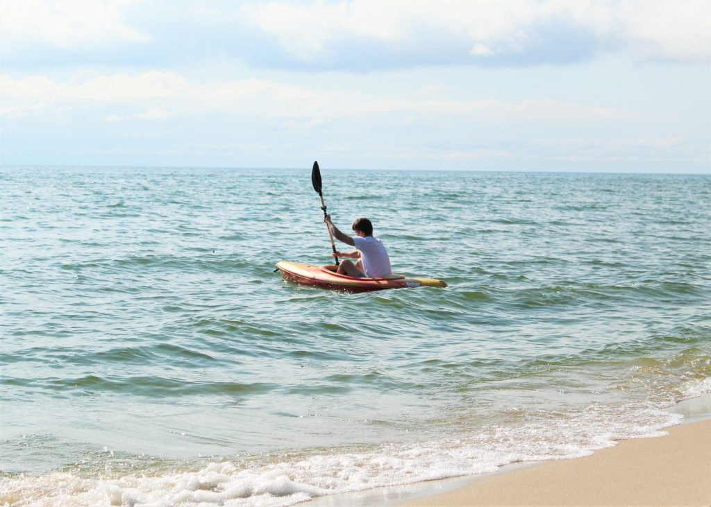 There are plenty of ways to enjoy the beach and water at the campground, including kayaking.