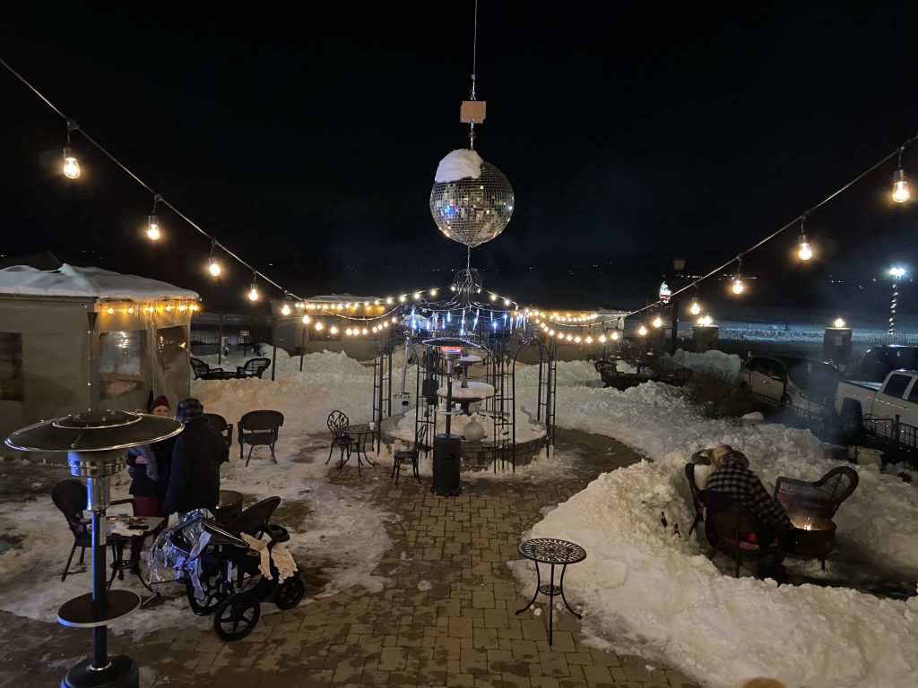 View of the Baker House setup at the Fire and Ice Bar during the Lake Geneva Winterfest. Cabanas, fire pits and heaters, surrounded with lots of snow on the ground.